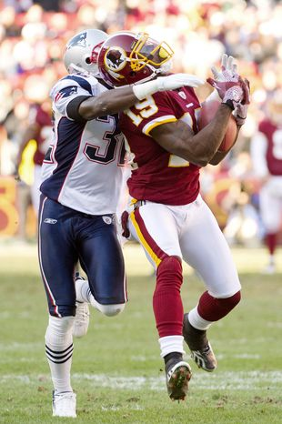 Washington Redskins wide receiver Donte' Stallworth (19) pulls in a 51 yard reception against defender New England Patriots cornerback Devin McCourty (32) in the first quarter. (Andrew Harnik / The Washington Times)
