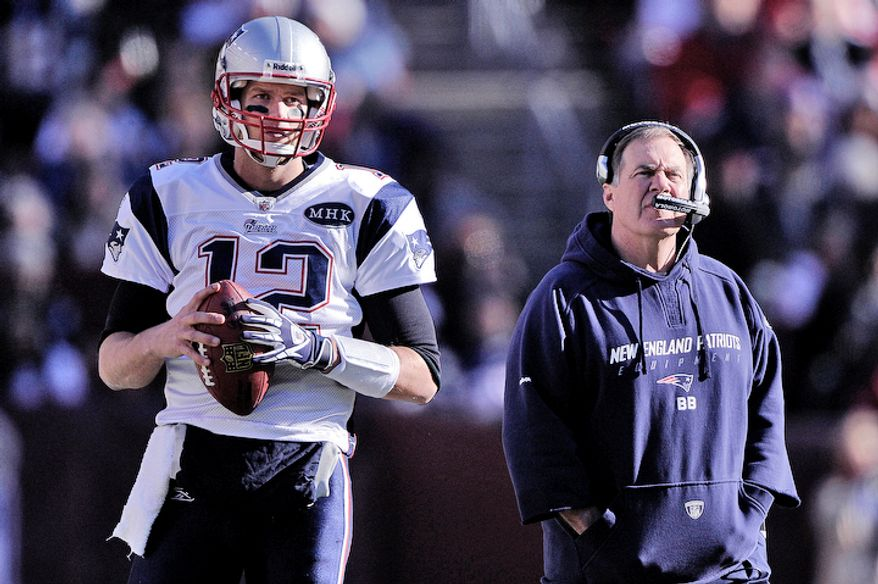 New England Patriots quarterback Tom Brady (12) and head coach Bill Belichick watch the big screen as they review the first quarter reception by tight end Rob Gronkowski (87). (Preston Keres/Special to The Washington Times)