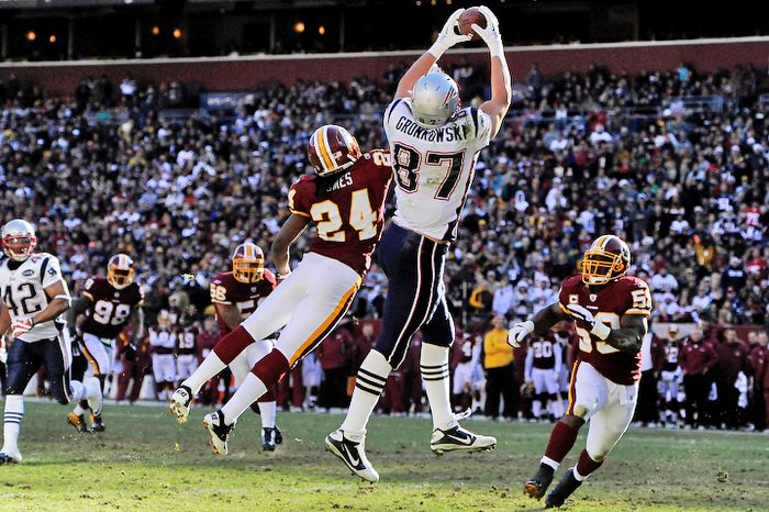 New England Patriots tight end Rob Gronkowski (87) hauls in a first quarter touchdown in front of Washington Redskins strong safety DeJon Gomes (24) and inside linebacker London Fletcher (59). (Preston Keres/Special to The Washington Times)