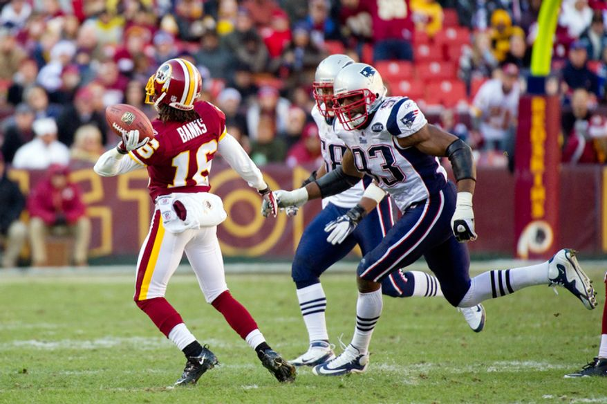 Washington Redskins wide receiver Brandon Banks (16) throws a 49 yard touchdown pass to Santana Moss (89) in the second quarter. (Andrew Harnik / The Washington Times)