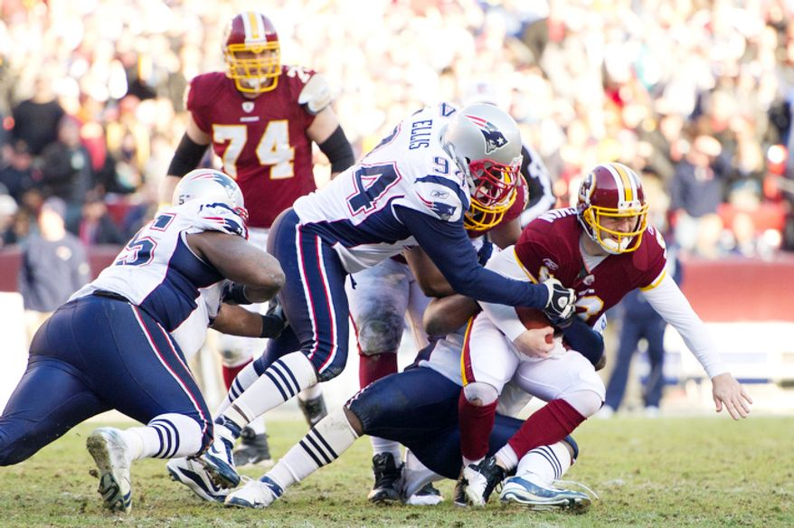 New England Patriots defensive end Brandon Deaderick (71) sacks Washington Redskins quarterback Rex Grossman (8) for a 3 yard loss in the second quarter. (Andrew Harnik / The Washington Times)