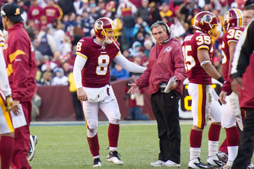 Washington Redskins head coach Mike Shanahan shows his frustration at Washington Redskins quarterback Rex Grossman (8) after throwing an interception in the second quarter. The ball went back to the Redskins on a roughing the passer penalty. (Andrew Harnik / The Washington Times)