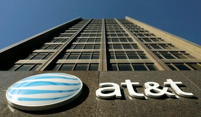AT&T Inc. and the Justice Department agreed Dec. 12, 2011, to put off their upcoming antitrust trial over the phone company's proposed acquisition of smaller rival T-Mobile USA. (Associated Press)