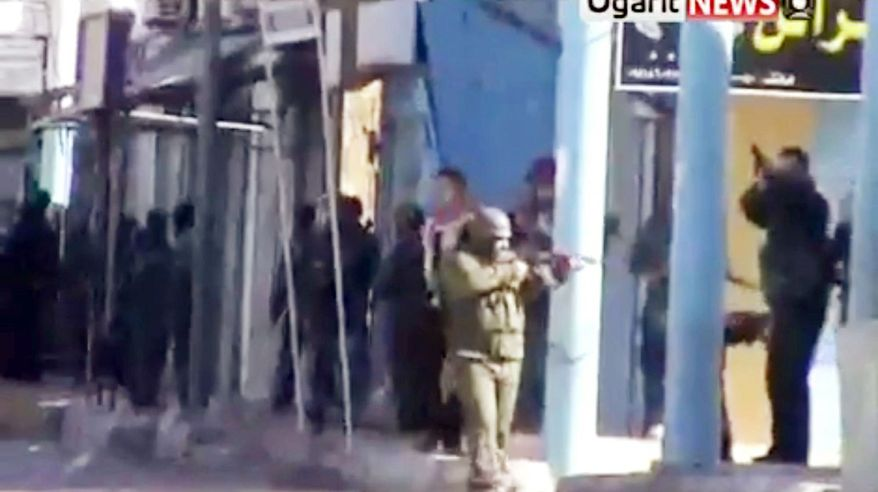 Amateur video is said to show security forces in Daraa, Syria, on patrol Monday as many Syrians closed shops and kept their children home from school in a show of civil disobedience. (Ugarit News Group via Associated Press)