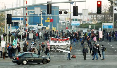 """Protesters in Oregon set up a picket line at a Port of Portland terminal on Monday, a """"day of action"""" on the West Coast that affected shipping from California to British Columbia. The anti-Wall Street protesters had the idea that if they cut off the ports, they cut into corporate profits. (Associated Press)"""