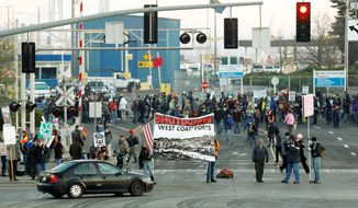 "Protesters in Oregon set up a picket line at a Port of Portland terminal on Monday, a ""day of action"" on the West Coast that affected shipping from California to British Columbia. The anti-Wall Street protesters had the idea that if they cut off the ports, they cut into corporate profits. (Associated Press)"