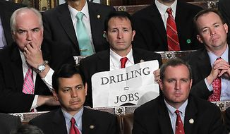 ** FILE ** Rep. Jeff Landry, Louisiana Republican, holds a sign during a speech by President Obama to a joint session of Congress at the Capitol in Washington on Thursday, Sept. 8, 2011. (AP Photo/J. Scott Applewhite)