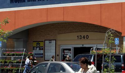 **FILE** Customers leave a Lowe's Home Improvement Warehouse store in San Bruno, Calif., on May 22, 2006. (Associated Press)