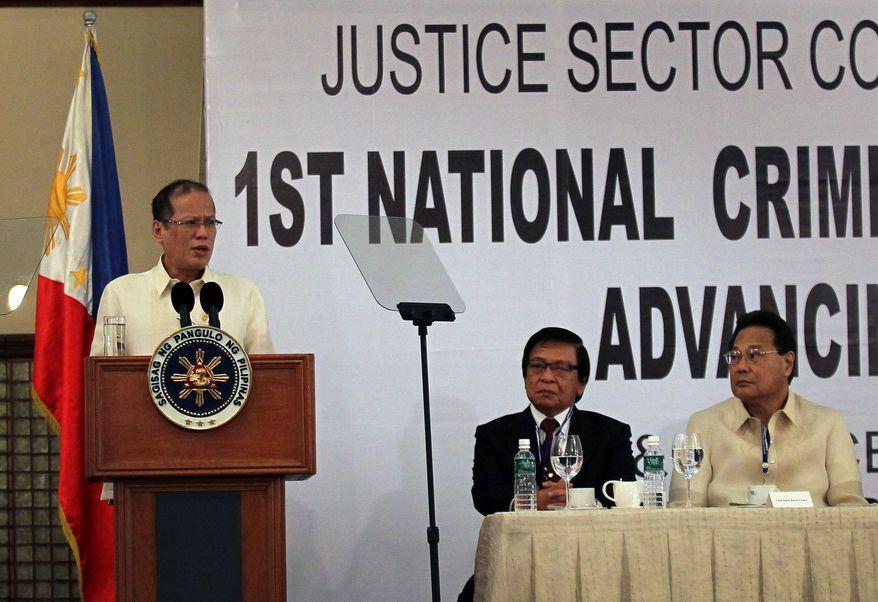 Philippine President Benigno Aquino III (left) addresses the National Criminal Justice Summit in Manila on Monday, Dec. 5, 2011, as Supreme Court Chief Justice Renato Corona (right) and Anti-Graft Court Presiding Justice Francisco Villaluz Jr. listen. (AP Photo/Malacanang Palace Photo Bureau, Gil Nartea)