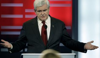 ** FILE ** Republican presidential hopeful Newt Gingrich speaks Dec. 10, 2011, during a GOP presidential debate in Des Moines, Iowa. (Associated Press)