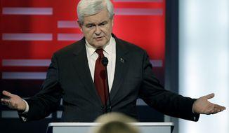 ** FILE ** Republican presidential hopeful Newt Gingrich speaks Dec. 10, 2011, during a GOP presidential debate in Des Moines, Iowa. (Associated Press)