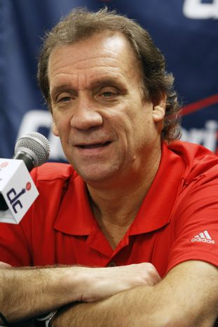Washington Wizards coach Flip Saunders speaks to the media about the upcoming NBA basketball season during a news conference in Washington, on Friday, Dec. 2, 2011. (AP Photo/Jacquelyn Martin)
