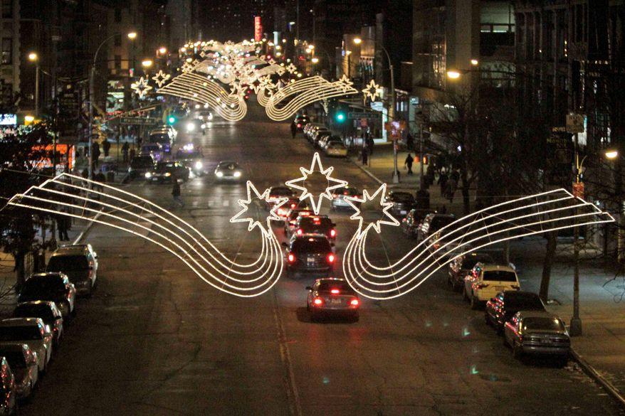 **FILE** Christmas lights illuminate 125th Street in Harlem. (Associated Press)