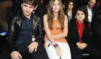 """Paris Jackson, seen in March with brothers Prince Michael (left) and Blanket, will talk about her movie, """"Lundon's Bridge,"""" on Ellen DeGeneres' show on Wednesday. (FOX via Associated Press)"""