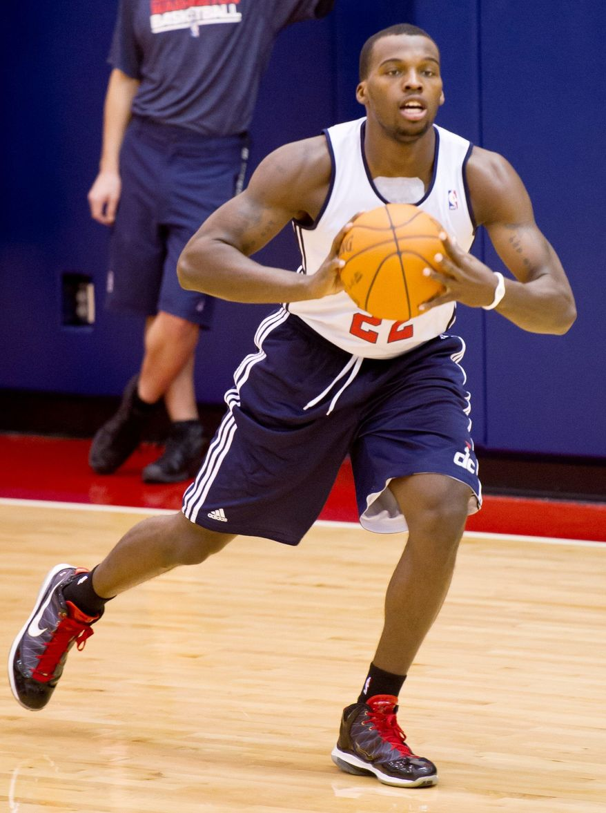 Washington Wizards guard Shelvin Mack passes the ball at practice during training camp at the Verizon Center, Tuesday, December 13, 2011. (Andrew Harnik / The Washington Times)