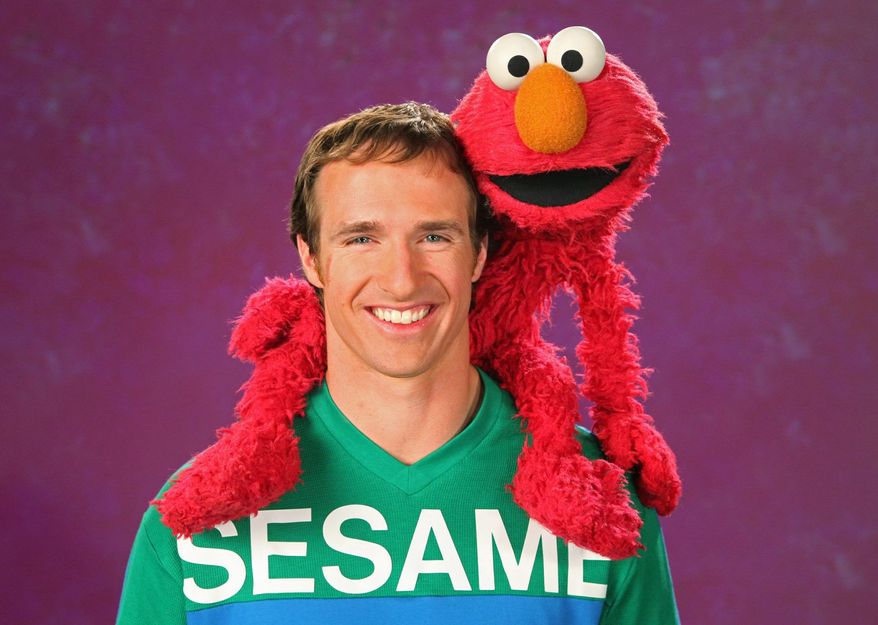 """New Orleans Saints quarterback Drew Brees will join Elmo for Thursday's episode of the children's show """"Sesame Street."""" He visited the set a few months ago, before the start of the NFL season, to record the segment. (Sesame Street via Associated Press)"""