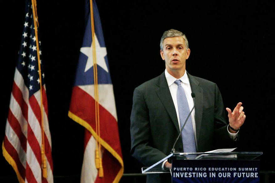 U.S. Secretary of Education Arne Duncan delivers a speech during the Puerto Rico Education Summit in San Juan, Puerto Rico, on Monday, Oct. 17, 2011. (AP Photo/Ricardo Arduengo)