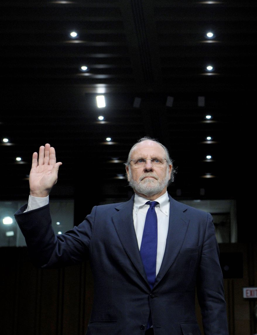 Former MF Global Holdings CEO Jon Corzine is sworn in Tuesday to testify before the Senate Agriculture Committee on the company's bankruptcy. A later witness challenged Mr. Corzine on when he knew of the transfer of customers' money. (Associated Press)