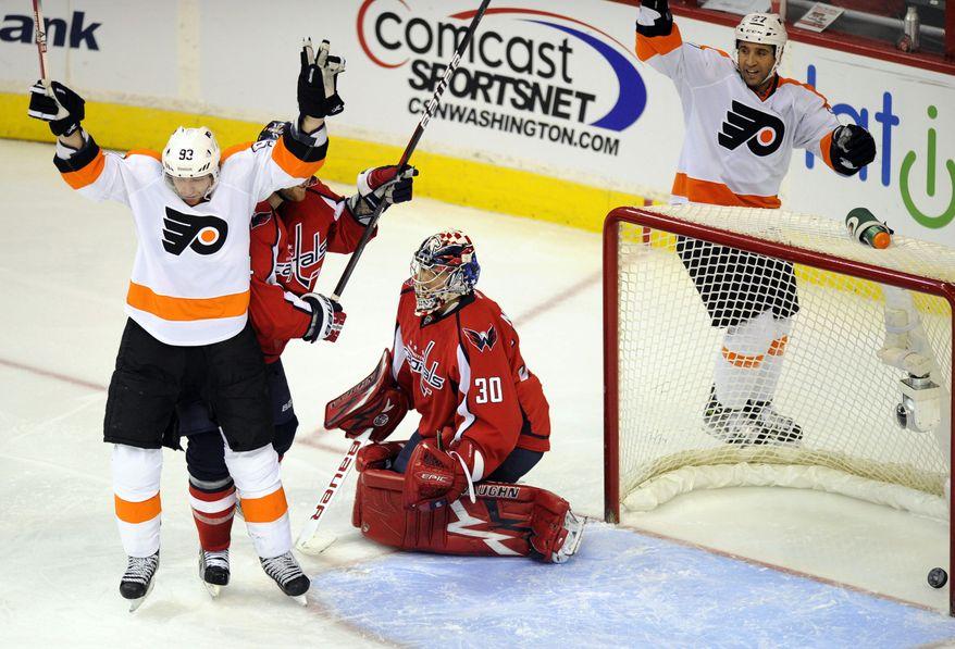 Philadelphia Flyers right wing Jakub Voracek (93) celebrates his goal as Washington Capitals goalie Michal Neuvirth reacts during the third period of an NHL game, Tuesday, Dec. 13, 2011, in Washington. (AP Photo/Nick Wass)