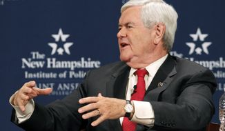 Former House Speaker Newt Gingrich participates in a one-on-one GOP presidential candidate debate with former Utah Gov. Jon Huntsman in Manchester, N.H., on Monday, Dec. 12, 2011. (AP Photo/Elise Amendola)