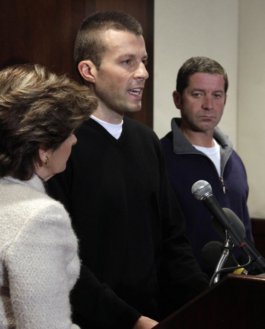 Former Syracuse ball boy Bobby Davis (center) addresses the media as former ball boy Mike Lang (right) and lawyer Gloria Allred look on during a news conference on Tuesday, Dec. 13, 2011, in New York. (AP Photo/Richard Drew)