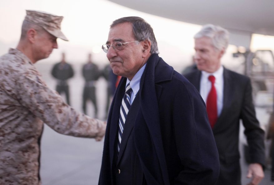 Defense Secretary Leon E. Panetta walks to his vehicle after being greeted by Ryan Crocker (right), U.S. ambassador to Afghanistan, and Gen. John Allen (left) upon arriving in Kabul, Afghanistan, on Tuesday, Dec. 13, 2011. (AP Photo/Pablo Martinez Monsivais, Pool)