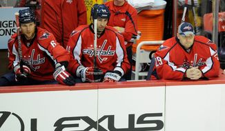 Washington Capitals goalie Tomas Vokoun (right) was pulled Tuesday night against the Philadelphia Flyers after surrendering four goals in two periods. After the 5-1 loss, the Caps are 15-13-1 on the season. (Associated Press)