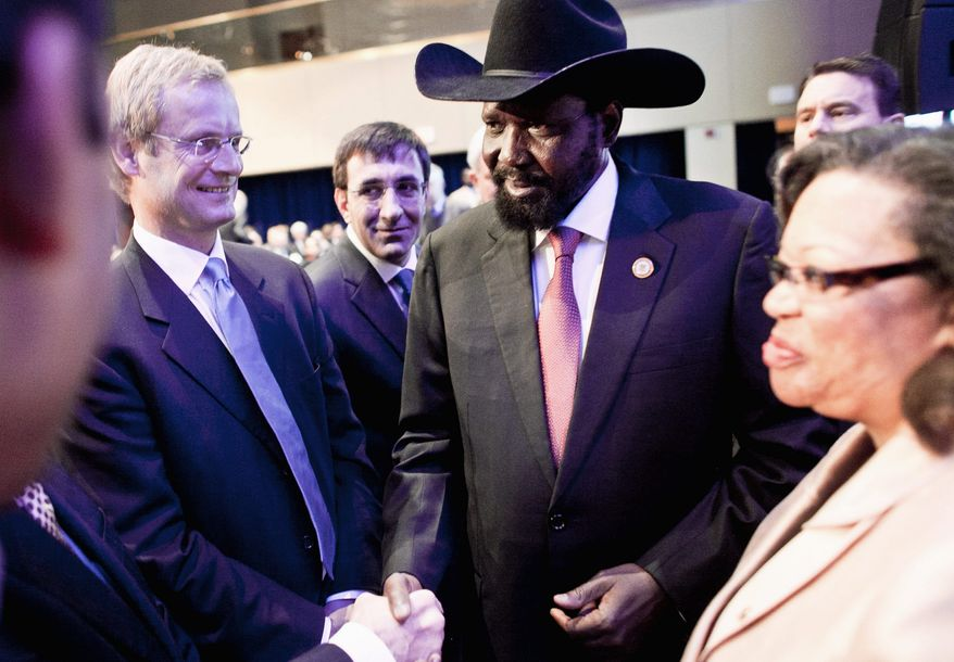 South Sudan President Salva Kiir Mayardit greets the European co-sponsors of the International Engagement Conference, including (from left) Endre Stiansen, special envoy from the Norwegian Ministry of Foreign Affairs; Cevdet Yilmaz, minister of the Turkish Ministry of Development, and Susan Page, U.S. ambassador to the Republic of South Sudan, after speaking about the Republic of South Sudan at the Marriott Wardman Park on Wednesday. (T.J. Kirkpatrick/The Washington Times)