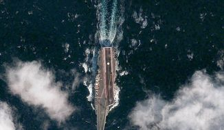 "The Chinese aircraft carrier Varyag undergoes its second round of sea trials in the Yellow Sea. Michele Flournoy, the Pentagon's undersecretary of defense for policy, says it has been ""anticipated for a while."" (Digital Globe)"