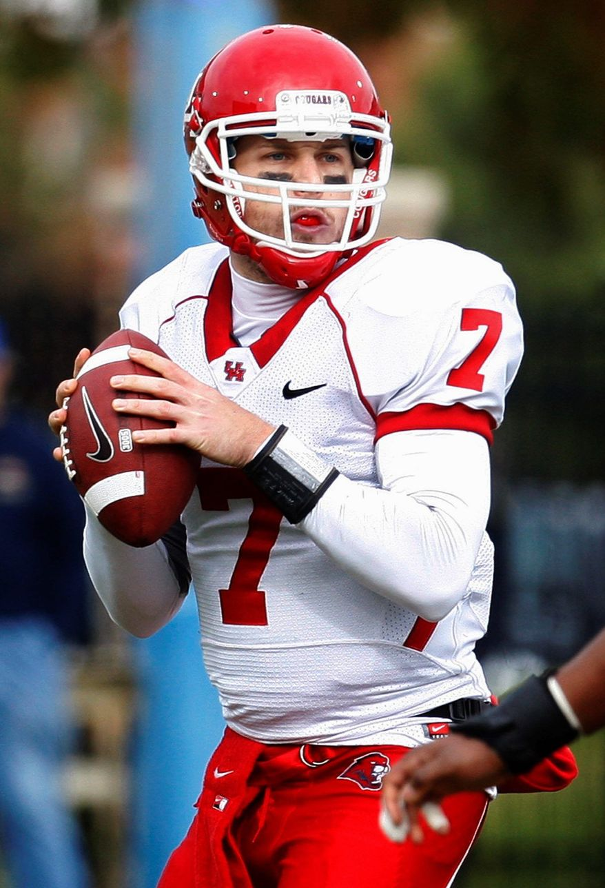 Houston quarterback Case Keenum, the NCAA's all-time passing leader, directs an offense averaging a nation's-best 599 yards per game. The Cougars face Penn State in the TicketCity Bowl on Jan. 2. (Associated Press)