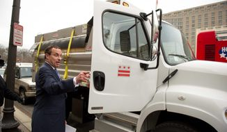 Mr. Gray gets into a 2012 Freightliner dump truck after discussing his new strategy for dealing with winter weather. (Rod Lamkey Jr./The Washington Times)