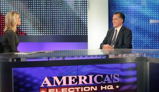 Martha MacCallum interviews former Massachusetts Gov. Mitt Romney, a Republican presidential candidate, on the Fox News. Mr. Romney is taking some heat for trying to make a $10,000 bet with Texas Gov. Rick Perry at Saturday's debate. (Associated Press)