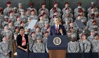 President Obama, accompanied by first lady Michelle Obama, speaks to troops at Fort Bragg, N.C., on Wednesday, Dec. 14, 2011. (AP Photo/Gerry Broome) ** FILE **