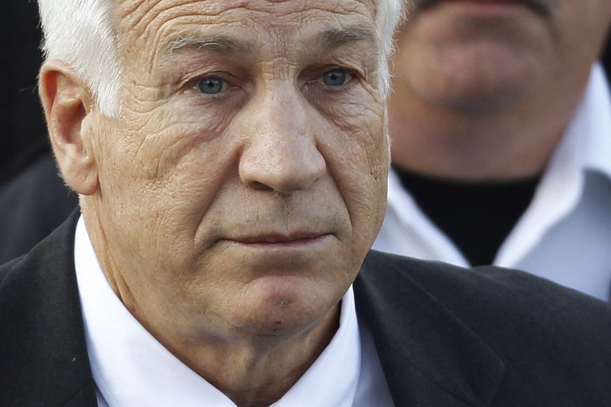 Jerry Sandusky, the former Penn State assistant football coach charged with sexually abusing boys, leaves the Centre County Courthouse in Bellefonte, Pa., Tuesday, Dec. 13, 2011, after waiving his preliminary hearing. (AP Photo/Matt Rourke)