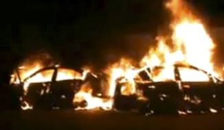 Cars burn after being attacked by supporters of Syrian President Bashar Assad in Homs, Syria, on Tuesday, Dec. 13, 2011, in this image taken from amateur video. (AP Photo/Sham News Network via Associated Press Television News)