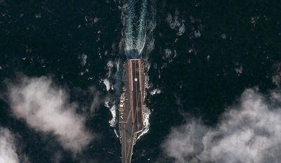 A satellite image taken on Thursday, Dec. 8, 2011, and provided by the DigitalGlobe Analysis Center shows the Chinese aircraft carrier Varyag sailing in the Yellow Sea approximately 60 miles south-southeast of the port of Dalian, China. (AP Photo/DigitalGlobe)