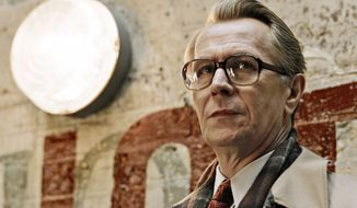 "Gary Oldman portrays George Smiley, who is called out of retirement from MI6 when a covert operation goes awry, in the latest but not greatest adaptation of ""Tinker, Tailor, Soldier, Spy."" (Focus Features via Associated Press)"