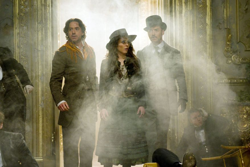 """""""Sherlock Holmes: A Game of Shadows"""" stars Robert Downey Jr. (left) as Holmes, Jude Law (right) as Dr. Watson and Noomi Rapace in director Guy Ritchie's stylized reimagining of Arthur Conan Doyle's beloved sleuth. (Warner Bros. Pictures via Associated Press)"""