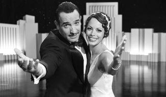 """The silent-film-era movie """"The Artist,"""" starring Jean Dujardin and Berenice Bejo, received six Golden Globes nominations. (AP Photo/The Weinstein Company)"""