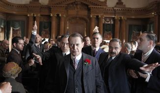 """In this image released by HBO, Steve Buscemi, center, is shown in a scene from the HBO series, """"Boardwalk Empire."""" The show was nominated for a Golden Globe award for best TV drama series. Buscemi was also nominated for best actor in a TV drama series. (AP Photo/HBO, Macall B. Polay)"""
