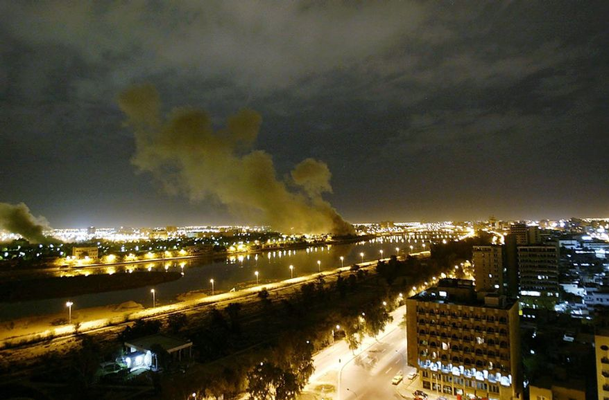 "In this March 20, 2003 file photo, smoke rises from the Trade Ministry in Baghdad after it was hit by a missile during US-led forces attacks. In the beginning, it all looked simple: topple Saddam Hussein, destroy his purported weapons of mass destruction and lay the foundation for a pro-Western government in the heart of the Arab world. Nearly 4,500 American and more than 100,000 Iraqi lives later, the objective now is simply to get out _ and leave behind a country where democracy has at least a chance, where Iran does not dominate and where conditions may not be good but ""good enough."" (AP Photo/Jerome Delay, File)"
