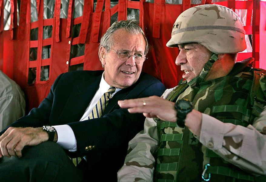 """In this May 13, 2004, file photo, Secretary of Defense Donald Rumsfeld, left, listens to Gen. Ricardo Sanchez, Commander of the coalition forces in Iraq, during his flight from Kuwait City to Baghdad. In the beginning, it all looked simple: topple Saddam Hussein, destroy his purported weapons of mass destruction and lay the foundation for a pro-Western government in the heart of the Arab world. Nearly 4,500 American and more than 100,000 Iraqi lives later, the objective now is simply to get out _ and leave behind a country where democracy has at least a chance, where Iran does not dominate and where conditions may not be good but """"good enough."""" (AP Photo/David Hume Kennerly, Pool, File)"""