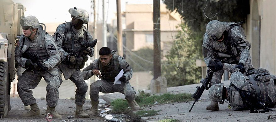 "In this Nov. 8, 2007 file photo, U.S. Army soldiers from Demon Company, 2nd Battalion, 7th Cavalry Regiment, 4th Brigade, 1st Cavalry Division react after coming under fire, leaving one soldier wounded, right, in western Mosul, 360 kilometers (225 miles) northwest of Baghdad. In the beginning, it all looked simple: topple Saddam Hussein, destroy his purported weapons of mass destruction and lay the foundation for a pro-Western government in the heart of the Arab world. Nearly 4,500 American and more than 100,000 Iraqi lives later, the objective now is simply to get out _ and leave behind a country where democracy has at least a chance, where Iran does not dominate and where conditions may not be good but ""good enough.""  (AP Photo/Maya Alleruzzo, File)"