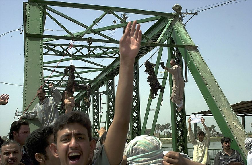 """In this March 31, 2004 file photo, Iraqis chant anti-American slogans as charred bodies hang from a bridge over the Euphrates River in Fallujah, west of Baghdad, in Iraq. In the beginning, it all looked simple: topple Saddam Hussein, destroy his purported weapons of mass destruction and lay the foundation for a pro-Western government in the heart of the Arab world. Nearly 4,500 American and more than 100,000 Iraqi lives later, the objective now is simply to get out _ and leave behind a country where democracy has at least a chance, where Iran does not dominate and where conditions may not be good but """"good enough."""" (AP Photo/Khalid Mohammed, File)"""