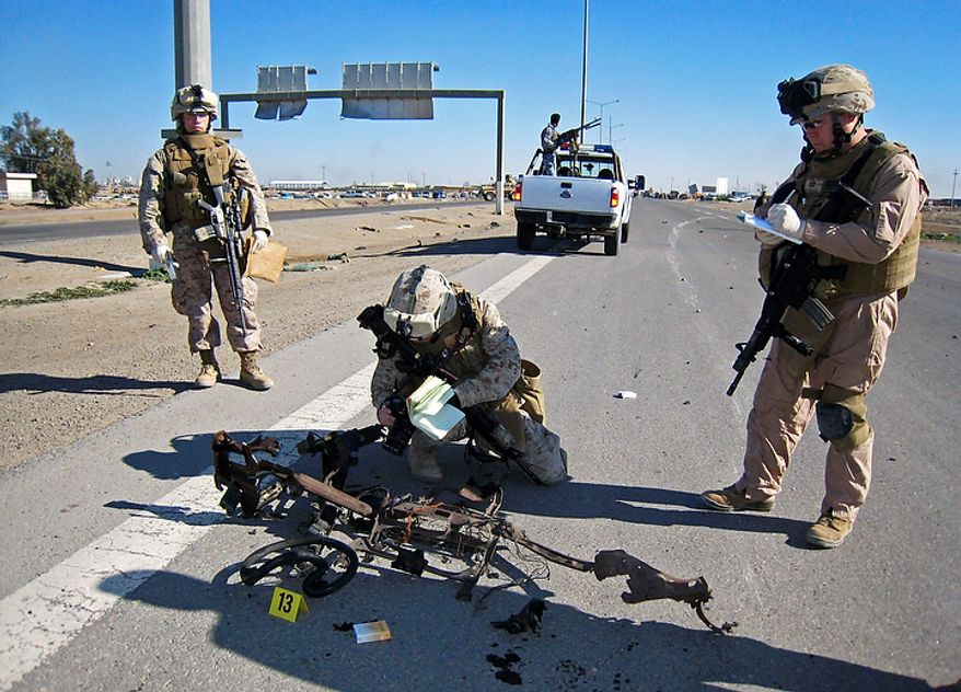 In this Sunday, Dec. 28, 2008 file photo, U.S. marines are seen at the scene of car bombing just outside Fallujah, Iraq.  With the Iraq war ending and an Afghanistan exit in sight, the Marine Corps is beginning a historic shift _ a return to its roots as a seafaring force that will get smaller, lighter and, it hopes, less bogged down in land wars. (AP Photo/Bilal Fawzi, File)