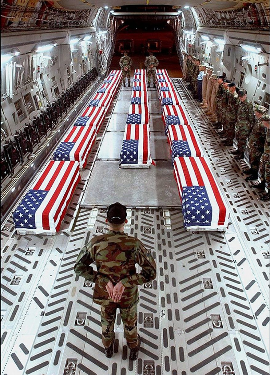 "In this undated U.S. Department of Defense file photo made available by thememoryhole.org, flag-draped coffins of U.S .war casualties are seen aboard a cargo plane in Dover, Del. In the beginning, it all looked simple: topple Saddam Hussein, destroy his purported weapons of mass destruction and lay the foundation for a pro-Western government in the heart of the Arab world.. Nearly 4,500 American and more than 100,000 Iraqi lives later, the objective now is simply to get out _ and leave behind a country where democracy has at least a chance, where Iran does not dominate and where conditions may not be good but ""good enough.""  (AP Photo/thememoryhole.org, File)"