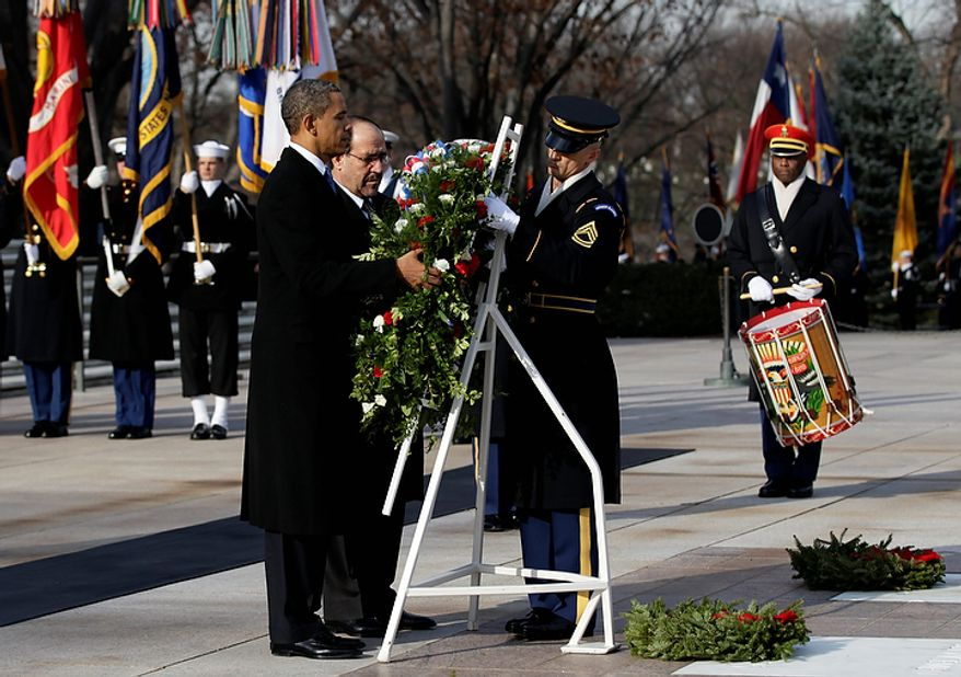 President Barack Obama and Iraq's Prime Minister Nouri al-Maliki lay a wreath at the Tomb of the Unknowns, Monday, Dec. 12, 2011, at Arlington National Cemetery in Arlington, Va. (AP Photo/Carolyn Kaster)