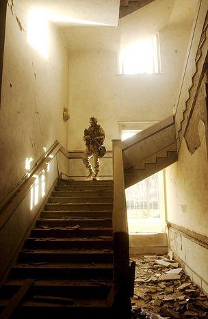 A US Marine walks through the rubble of the Iraqi Parliment Building in Saddam Hussein's Palace complex near the Tigris River Saturday, April 12, 2003. ( J.M. Eddins Jr. / The Washington Times )