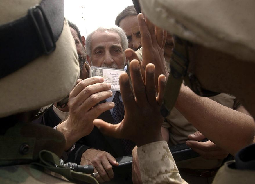 Iraqi citizens claiming to be civil police, engineers and doctors answered a broadcast on BBC radio to come to the Palestine Hotel in Baghdad, Iraq as the US military begins trying to establish a civilian force to restore  order and public utilities Saturday, April 12, 2003. ( J.M. Eddins Jr. / The Washington Times )