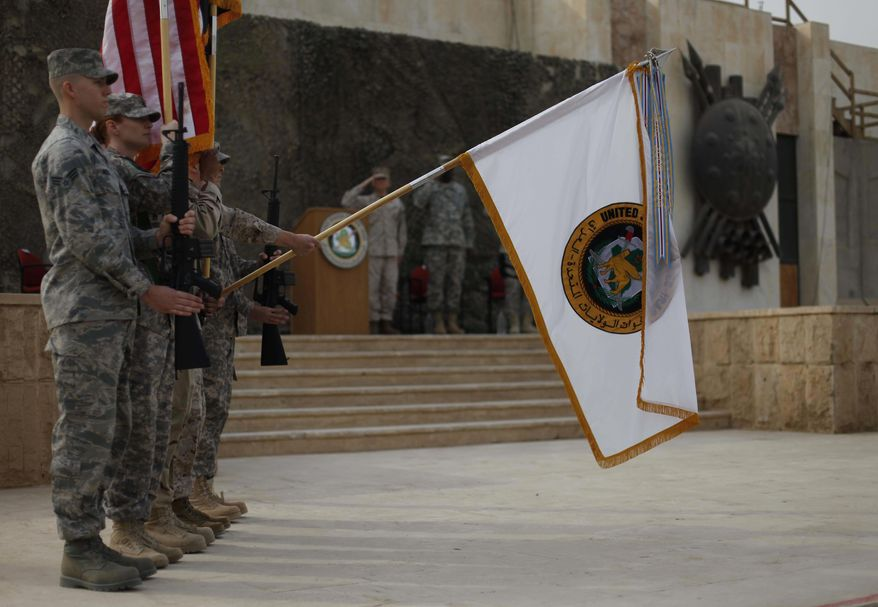 The US Forces Iraq colors are lowered before being encased in a ceremony in Baghdad, Iraq, Thursday, Dec., 15, 2011. The ceremonies mark the official end of the U.S. military mission in Iraq. (AP Photo/Pablo Martinez Monsivais, Pool)